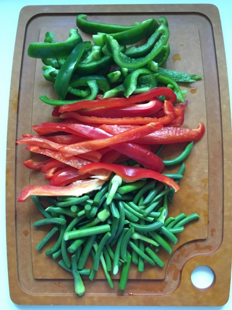 Sausage with Onions, Peppers + Garlic Scapes Recipe // @nicoledula #whole30
